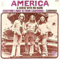 """March 25th,1972, America Was At #1 On The U.S. Singles Chart With """"A Horse With No Name"""" It Was The Band's First & Most Successful Single Topping The Charts In Several Countries. Released In Late 1971 In Europe & Early 1972 In The U.S. Despite The Song Being Banned By Some U.S. Radio Stations, Most Notably WHB In Kansas City, Because Of Supposed Drug References To Heroin Use, The Song Ascended To #1 On The U.S. Billboard Hot 100 & The Album Quickly Reached Platinum Status."""