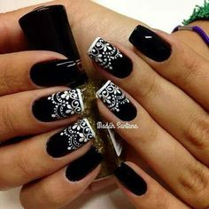 Black nails with white design                              …