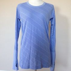 Lululemon blue long sleeve Like new! No signs of wear. Size 10. It has a light blue/dark blue stitching. Stripe diagonal pattern. Thumb holes. Light weight. No trades please. lululemon athletica Tops Tees - Long Sleeve