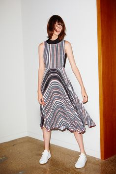 Made from linear graphic stripes with front and back knife pleats. This dress is designed with a pre-styled crop top creating a flattering silhouette making it equally appropriate for work and play -