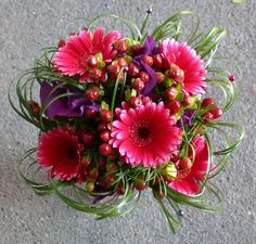 {A Very Pretty & Uniquely Arranged Wedding Bouquet Featuring: Hot Pink Gerbera Daisies, Purple Lisianthus, Red Hypericum Berries & Green Lily Grass}