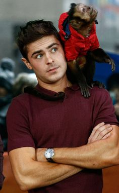 Zac Efron and a Monkey from Zac Efron and Animals The only thing we might want to see more than Zac Efron's handsome face is a monkey wearing a jacket. Thankfully, we do not have to choose between the two in this picture, taken during a stop at The Today Show.