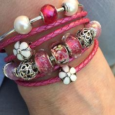 Early morning sun on a pink bouquet of Essence pearls, daisies and pink beauties.  #theofficialpandora #pandorabracelets #pandora #pearls #pink #new #beads #leather #flowers #daisy #love