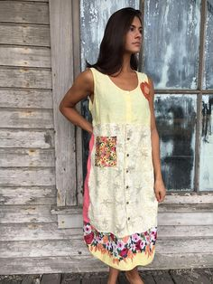Romantic/Tattered/Rustic/Gypsy/Boho Dress upper part of dress is made with cotton and has added knit flower along front lower part is made with a variety of panels and has pocket sling front and tie along back Size-medium large chest-44 hips-48 length-42