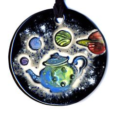 Russell's Teapot and Planets Ceramic Necklace by surly on Etsy, $22.00