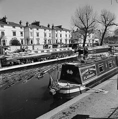 View of narrow boats on the Grand Union Canal, with the passenger boat 'Jason' passing, and stuccoed houses at Blomfield Road beyond. London Pictures, London Photos, Maida Vale, Julie Christie, English Heritage, Narrowboat, Notting Hill, Old London, Ephemera
