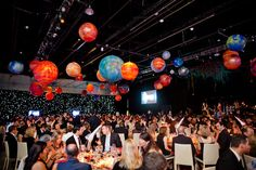 Dinner was served in the Exhibition Hall of the Ontario Science Centre, where planets hung overhead and a wall of LED lights mimicked a starry sky. The first annual Innovator's Awards were presented on stage.