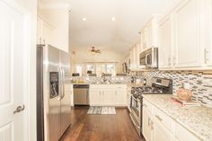 From the floors to the CEILING, do you find this kitchen APPEALING?!