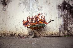 Whimsical New Murals by Ernest Zacharevic Play with Their Surroundings on the Streets of Malaysia street art murals Malaysia★★★