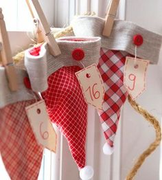 Advent Calendar Lineup: Stocking Caps, Use holiday stocking caps for an Advent calendar clothesline. Sew a button to each cap and tie a numbered tag around it.