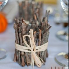 Adorable centerpiece idea for a country wedding... Just add in some flowers and put some small items around it.  Sunflower petals?