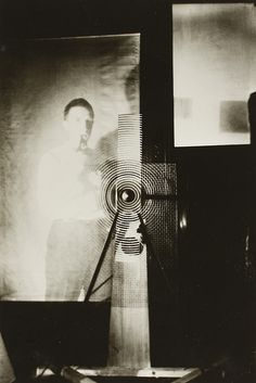 Duchamp behind the Rotary Glass Plates in motion, 1920 by Man Ray
