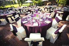 Eggplant Satin Linens with White Polyester Chair Covers and Matching Satin Eggplant Sashes.