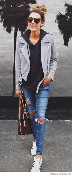 Blue jeans, sport blouse and a grey jacket