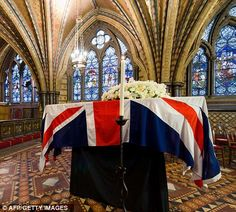 The coffin of British former prime minster Margaret Thatcher rests in the Crypt Chapel of St Mary Undercroft beneath the Houses of Parliament on Tuesday night.