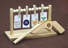 FREE RUBBER BAND GUN woodworking plans and information at WoodworkersWorkshop® Toy, Rubberband Gun - with targets, free plans projects patterns woodworking. Woodworking For Kids, Woodworking Toys, Easy Woodworking Projects, Popular Woodworking, Woodworking Furniture, Furniture Plans, Kids Furniture, Woodworking Articles, Woodworking Software