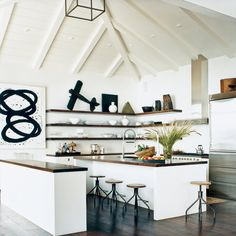 Kitchen Gone Mod: Kitchens—especially contemporary ones—clamor for white. But the addition of dark countertops is a great way to provide a needed punch of sophistication to a white color palette without looking like you're trying too hard.   CoastalLiving.com