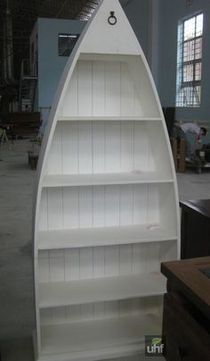 Boat shaped bookshelf for guest room