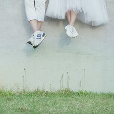 Couple, Front  facing, Half body shot, Shoes, wall, buildings, Casual or formal outfit