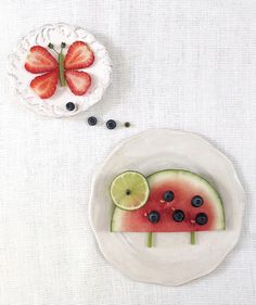 To make the lady bug: Slice one half-round slice from a small watermelon and place on a small plate. Slice one round from a lime and place on the top of the watermelon as an eye. Place one blueberry in the center of the eye. Use five larger blueberries to create the ladybug's dots. Cut celery into two thin, short pieces and use as legs.