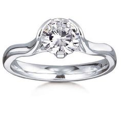 This round brilliant-cut solitaire engagement ring from MaeVona is named after the Scottish island of Boreray. The flowing asymmetric ring offers a fresh new look, featuring one prong and two demi-flush sides that bring the center stone to life.