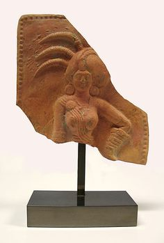 Plaque with a Royal Woman  Period: Shunga period Date: 1st century B.C. Culture: India Medium: Terracotta Dimensions: 6 x 5 1/4 in. (15.2 x 13.3 cm) Classification: Sculpture Credit Line: Gift of Mark and Supapon Schatten, in memory of Anthony Gardner, 1992 Accession Number: 1992.316