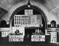 Photograph of a Berlin theater rented by Haeckel for a public   lecture on evolution about 1905. The enormous backdrop shows   embryos, skeletons, etc., relating man with the ape. (Reproduced   from Peter Klemm, Der Ketzer von Jena, Leipzig: Urania, 1968) #haeckel