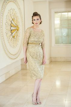 AideenBodkin Wisteria Dress. Knee length matte sequined gold lace dress, with a scalloped neck, elbow length sleeves and a scooped back.
