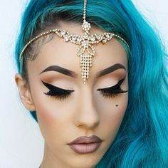 Idk what to pin this one to. I love the hair the head jewelry and makeup. I'm in love.