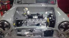 """A"" Series engines Mini Cooper S, Mini Cooper Classic, Classic Mini, Classic Cars, Minis, Mini Trucks, Red Interiors, Small Cars, Mk1"