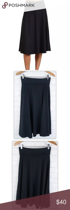 """Patagonia Morning Glory Fold-over Waist Midi Skirt Brand: Patagonia Style:  Mid calf/Midi length skirt Size:  Women's Small.  True to size.   This skirt is bound to become one of your favorites!  The trumpet style hem allows for a flirty movement with a fitted hip.  Super soft and stretchy quick-dry synthetic jersey material Fold over waistband Pull on style Trumpet hem with excellent drape Waist: 28"""" unstretched Length: 28"""" with waistband folded down Patagonia Skirts Midi"""