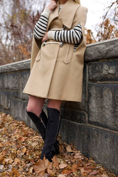 Knee high boots and a camel cape and striped sweater // Fall outfit ideas on Atlantic-Pacific