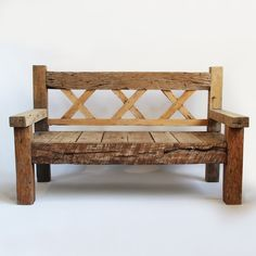 Reclaimed old wood bench with three X patterns across the back. Simple and square leg and arm design made from thick teak wood.