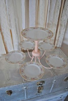 Do you have an old chandelier around? Take an outdated light fixture, paint it and add plates for a wonderful serving piece.