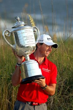 Rory McIlroy lifts the PGA Championship trophy after his victory Sunday at the Ocean Course. (Mic Smith/Special to The Post and Courier)