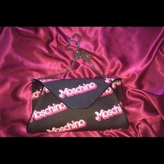 MOSCHINO BARBIE CLUTCH  MOSCHINO Barbie clutchFrom Spring Summer 2015 collection ! RARELY USED and still has TAGS on it(2nd photo). 3rd photo shows tiny lipstick stain but barely noticeable when worn!! I'm ALSO including 2 MOSCHINO look books ( man and woman fall winter 2015-2016) !!! (4th photo) Please message me if serious buyer or you want to make an offer! Original price was $595#clutch #moschino #barbie #purse #handbag Moschino Bags Clutches & Wristlets