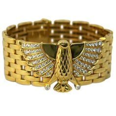 Cartier Iconic Horus Bracelet. An iconic gold tassel bracelet centering a representation of Horus, the ancient Egyptian God resembling an Eagle, embellished by fine brilliant cut diamonds both in its wings and legs. The item stresses the importance the Egyptian Revival in Cartier's work throughout the 20th century. Signed Cartier, circa 1978.