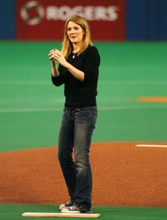 Pin for Later: Pitch Perfect — Stars Get Their Game On!  Drew Barrymore got ready to throw the first pitch at a Toronto Blue Jays game in October 2004.