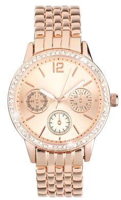 Material: Uhr mit einem Gliederarmband in Roségold und einem runden Zifferblatt, welches mit Strasssteinen verziert ist. Armband Breite: 1,5 cm Durchmesser Zifferblatt: 3 cm