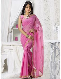 Winsome Beauty Saree Item code : SUD107   http://www.bharatplaza.in/new-arrivals/sarees/winsome-beauty-saree-sud107.html  Winsome beauty pink color chiffon saree with work patch border is decorated with gleaming kundan, cutdana, stones, zari, resham work motifs is making it real party wear. Exclusive saree will compliment to everyone taste of high fashion.