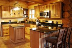 Cabin Charm - We enjoyed designing this charming kitchen for a new log home in the country. The kitchen features Shiloh Natural Hickory cabinetry with a mocha glaze and Cambria Quartz Nottingham countertops. Stainless accents kept the look modern and clean.