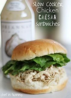SLOW COOKER CHICKEN CAESAR SANDWICHES    2 pounds boneless skinless chicken thighs or breasts (I used Chicken Breasts)  1/2 to 1 cup of your favorite Caesar dressing (I used Brianna's Asiago Caesar)  1/2 cup shredded Parmesan cheese  1/4 cup fresh chopped parsley or 2 tsp  dried parsley  1/2 teaspoon ground pepper  2 cups shredded romaine lettuce  12 slider buns or 4-6 regular sized hamburger buns