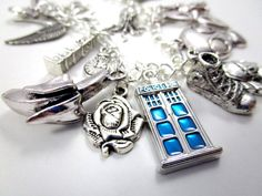 Inspired by everyones favorite Time Lord, this handmade charm bracelet features over a dozen iconic symbols from Doctor Who:  Double hearts Weeping