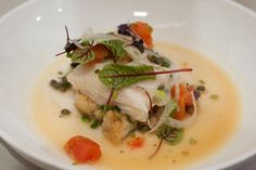 Olive Oil–Poached Red Snapper with Caramelized Cauliflower, Caper Berries, Tomatoes, Shaved Fennel and Red Veined Sorrel