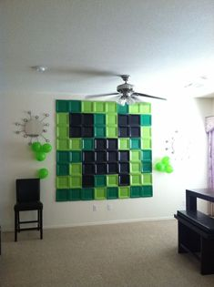 MC wall mural with colored, squared paper plates