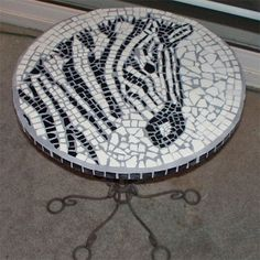 Use leftover tiles to make a mosaic tabletop zebra mosaic design. Mom would love this
