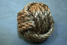Weighted Monkey's Fist Knot.  A popular weapon of the Barbary Coast, known as a 'Slung Shot'.