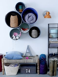 """Fun idea for storage! Hang buckets in a bunch on the wall and get new """"shelves""""."""
