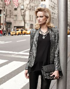 black, with a statement necklace and blazer.