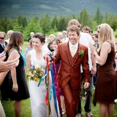 A DIY summer solstice wedding at an eco resort in rural BC. A vintage dress, orange tux, homegrown flowers, hula hoops and lawn games